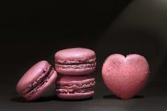 Pink macaroon. On black background Stock Image