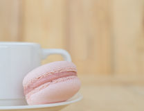 Pink Macaroon , Macaron with cup on wooden background. Pink Macaron , Macaroon with cup on wooden background stock photos