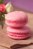 Pink macaroon with raspberry Stock Photography