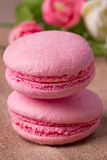 Pink macaroon with raspberry Royalty Free Stock Photo