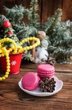 Pink macaroons with christmas decorations on wooden background Stock Image