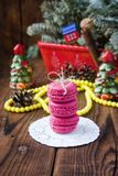 Pink macaroons with christmas decorations on woooden background Royalty Free Stock Photo