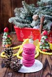 Pink macaroons with christmas decorations on woooden background Royalty Free Stock Images