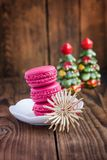 Pink macaroons with christmas decorations on woooden background Stock Photography