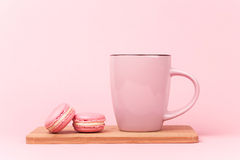 Pink macaroons with coffee Stock Image