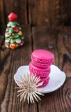 Pink macaroons with christmas decorations on woooden background Royalty Free Stock Image