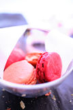 Pink macaroons in glass bowl Royalty Free Stock Photography