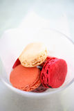 Pink macaroons in glass bowl Stock Images