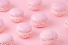 Pink macaroons homemade, on pink background, diagonal, selective focus. Pink macaroons on pink background, homemade food, toned, selective focus Stock Image