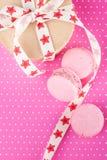 Pink macaroons and kraft gift box Royalty Free Stock Photo