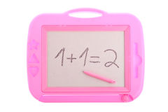 Pink magnetic drawing board with a 1 + 1 equation Stock Images