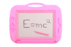 Pink magnetic drawing board with E=mc2 isolated Royalty Free Stock Image