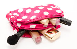 Pink make up bag with cosmetics isolated on a white Royalty Free Stock Image