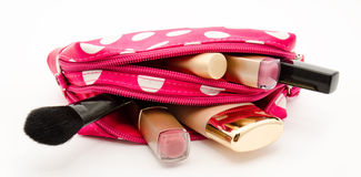 Pink make up bag with cosmetics isolated on a white Royalty Free Stock Photography