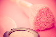 Pink makeup brush and eyeshadow. Closeup of pink eyeshadow and brush with vignetting Royalty Free Stock Photography