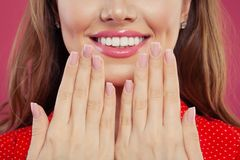 Pink makeup lips with trendy color glossy lipgloss. Beautiful female mouth and perfect white teeth.  stock image
