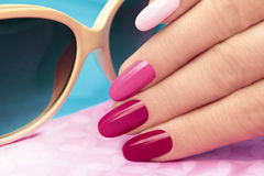 Pink manicure. Pink manicure covered different in tone nail Polish on oval shaped nails Royalty Free Stock Photos