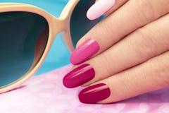 Pink manicure.
