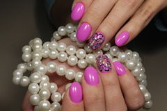 Pink Manicure Design Butterfly. Gentle manicure nail design gel with lacquer stock photography