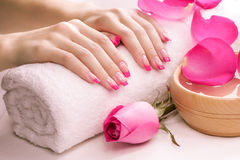 Pink manicure with towel. Spa Stock Image