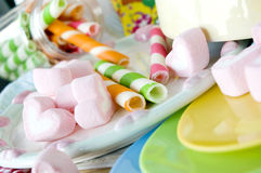 Marshmallow for kids. Pink marshmallow and colorful wafer stick for kids Stock Photos