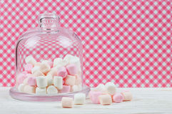 Pink marshmallow in a glass bell Royalty Free Stock Image