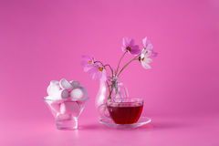 Pink marshmallow on pink background with flowers Stock Photo