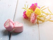 Pink marshmallow and Portulaca flowers Royalty Free Stock Photography