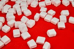 Pink marshmallow on red background. Valentine& x27;s Day stock photo