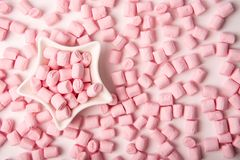 Pink marshmallow in star-shaped bowl for Valentine Day as background and texture.  royalty free stock image