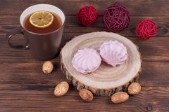 Pink marshmallow on wooden background stock photography
