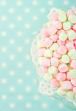 Pink marshmallows on blue background