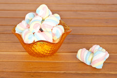 Pink marshmallows in the glass bowl. Marshmallows in the glass bowl on wooden background. Shallow depth of field Stock Photos