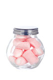 Pink marshmallows in the glass jar. Isolated on white background Stock Images