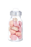 Pink marshmallows in the glass jar. Isolated on white background Stock Image