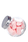 Pink marshmallows in the glass jar. Isolated on white background Royalty Free Stock Image