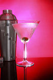 Pink Martinis and steel shaker. Cold Martini cocktails, olive and stainless steel shaker stock photos