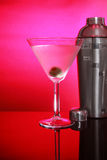 Pink Martinis and steel shaker. Cold Martini cocktails, olive and stainless steel shaker stock photo