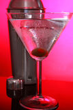 Pink Martinis and steel shaker. Cold Martini cocktails, olive and stainless steel shaker royalty free stock photography