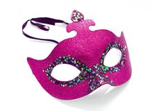 Pink mask. Pink carnival mask on white background Stock Photography