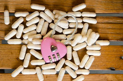 Pink master key on capsule drug Royalty Free Stock Images