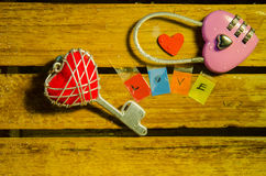 Pink master key with red heart key and love alphabet Royalty Free Stock Photo