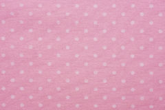 Pink material with dots, a background. Or texture stock photography