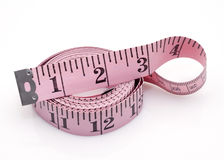 Pink measuring tape. Closeup of pink measuring tape Stock Photography