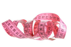 Pink measuring tape royalty free stock photos