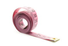 Measure. Pink measuring tape isolated on white background Stock Image