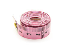 Measure. Pink measuring tape isolated on white background Stock Photography