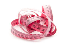Measure. Pink measuring tape isolated on white background Stock Photos