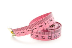 Measure. Pink measuring tape isolated on white background Stock Photo