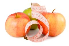 Pink measuring tape and three apples Royalty Free Stock Images